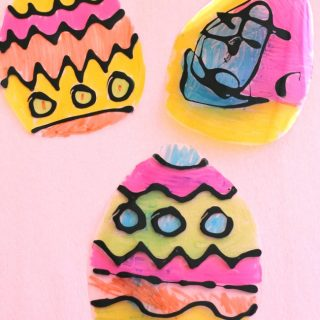 Such an easy idea for Easter crafts for kids! These black glue Easter egg suncatcher crafts are so pretty! #easter #eastercrafts ##eastercraftsforkids #howweelearn #craftsforkids #springcrafts #artsandcraftsforkids #artsandcrafts #blackglue #suncatcher