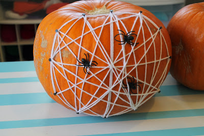 Anyone can make this easy spider web with yarn, nails and a few spiders. Weaving this web can be a calming activity that also strengthens fine motor skills and coordination. Here is a list of more pumpkin decorating ideas that toddlers, preschoolers and kids of all ages can create! #howweelearn #pumpkincarving #pumpkindecorating #jackolantern # halloween #kidsactivities