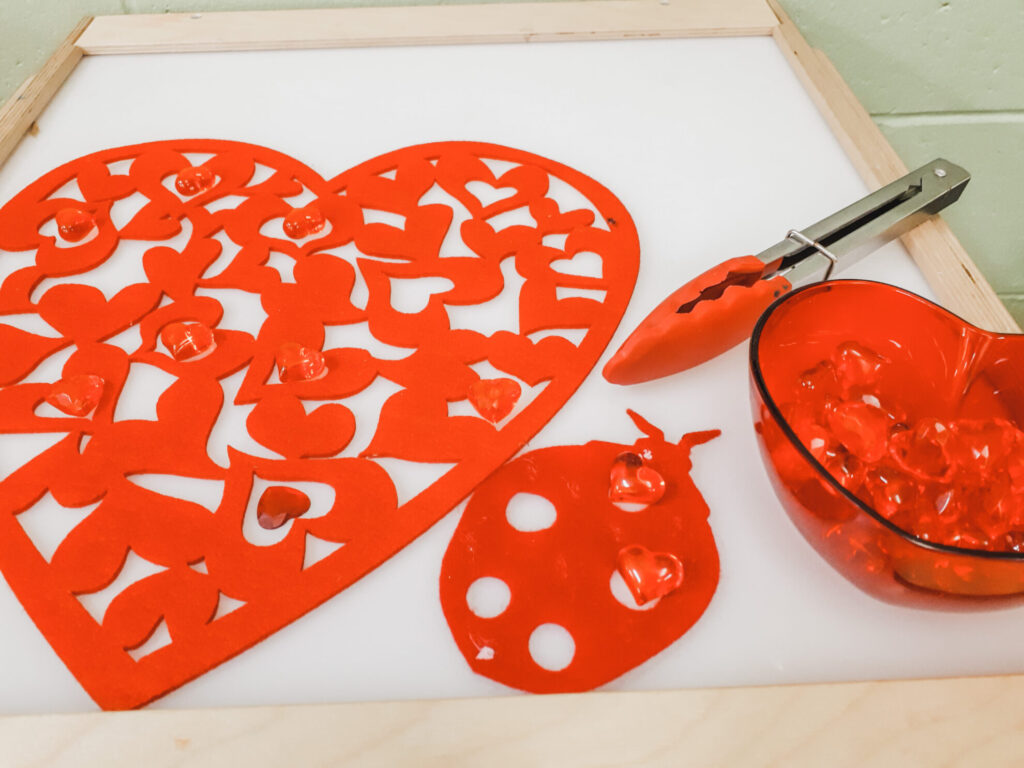 February Preschool classroom ideas - hearts on the light table