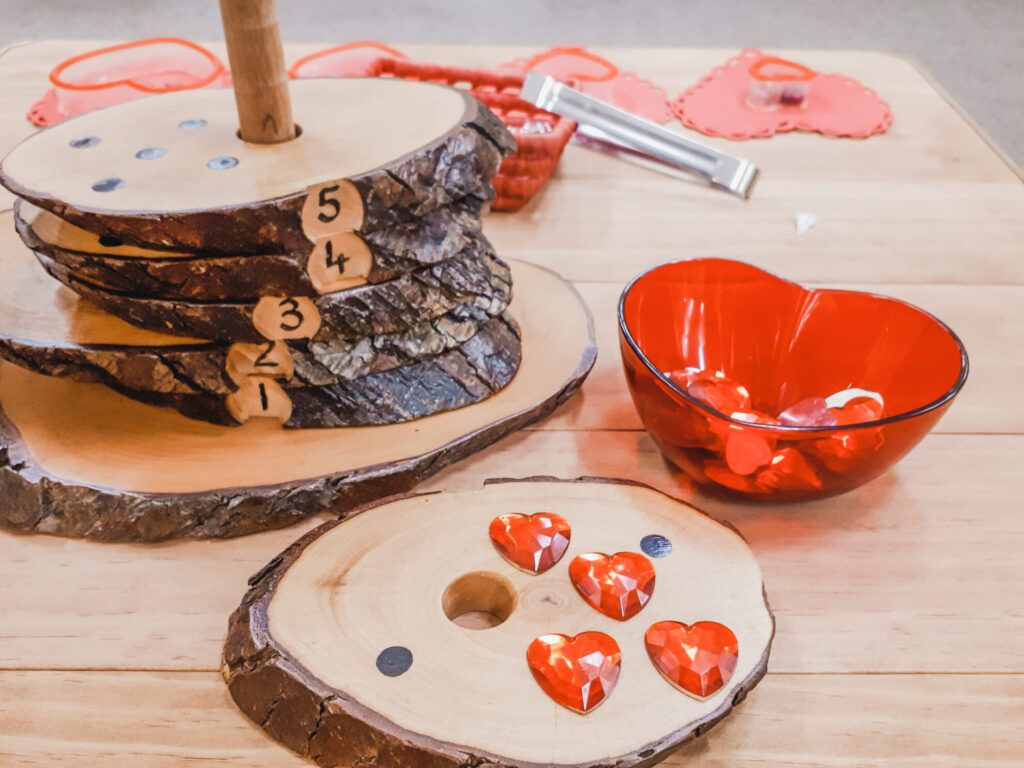 February preschool classroom ideas - wood slices with dots for one-to-one correspondence