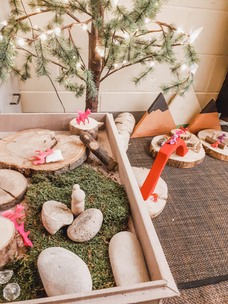 a quiet cozy space in the preschool classroom made of natural elements
