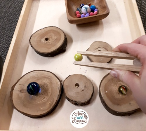 wood slices with marbles balancing on top as a preschool center